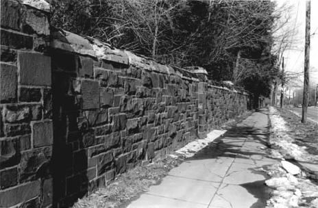 Contemporary view of the stone wall along Whitney Avenue